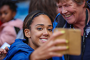 Katarina Johnson-Thompson of Great Britain & NI takes selfie with a fan during the Muller Grand Prix at Alexander Stadium, Birmingham, United Kingdom on 18 August 2019.