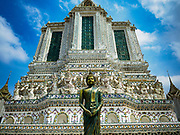 "11 SEPTEMBER 2017 - BANGKOK, THAILAND: Renovations are nearly finished at Wat Arun on the Thonburi side of the Chao Phraya River in Bangkok. Wat Arun is famous for its Khmer style main ""prang"" (chedi). It was originally built in the Ayutthaya Period and rebuilt to its current form in the time of Rama II.       PHOTO BY JACK KURTZ"