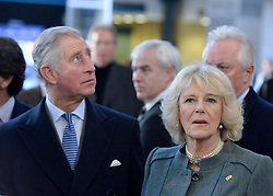 © Licensed to London News Pictures. 30/01/2013. London, UK Their Royal Highnesses look at the new ticket hall at Kings Cross St Pancras station. HRH The Prince of Wales and HRH The Duchess of Cornwall visit Farringdon Station in London today 30th January 2013. They were carrying out engagements to celebrate London Underground's 150th anniversary.]. Photo credit : Stephen Simpson/LNP