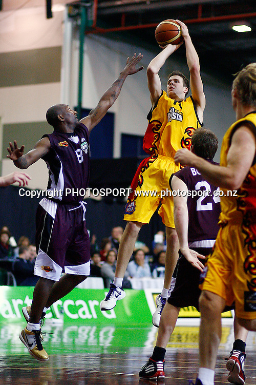 Pistons' Tony Ronaldson shoots a fade away jumper over Heat's Kavossy Franklin. 2010 NBL, Harbour Heat v Waikato Pistons, North Shore Events Centre, Auckland. Saturday 8th May 2010. Photo: Anthony Au-Yeung/PHOTOSPORT
