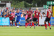 AFC Wimbledon midfielder Dean Parrett (18) is surrounded during the EFL Sky Bet League 1 match between AFC Wimbledon and Shrewsbury Town at the Cherry Red Records Stadium, Kingston, England on 24 September 2016. Photo by Stuart Butcher.