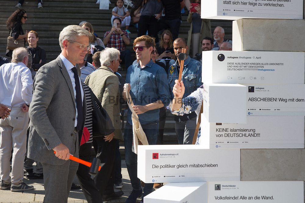 Berlin, Germany - 05.09.2017<br /> <br /> Together with some politicans the relief organization CARE is tearing down a wall of hatred messages on the Gendarmenmarkt in Berlin Mitte.<br /> <br /> Dr. Norbert R&ouml;ttgen (CDU) bei der Protestaktion von CARE. Die Hilfsorganisation CARE reisst zusammen mit Politikern eine Mauer mit Hass-Botschaften auf dem Gendarmenmarkt in Berlin Mitte ein.<br /> <br /> Photo: Bjoern Kietzmann