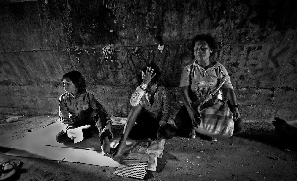 Mama Fin works for local NGO, Yayasan Harapan Ibu (YHI) or Mother's Hope (right) visits a young woman with AIDS living under a bridge in the city of Jayapura (middle).