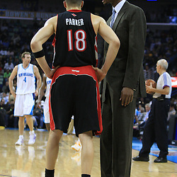 06 February 2009: Toronto Raptors guard Anthony Parker (18) talks with injured starter Chris Bosh on the court during a NBA game between the New Orleans Hornets and the Toronto Raptors at the New Orleans Arena in New Orleans, LA.