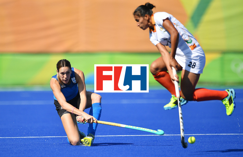 Argentina's Gabriela Aguirre (L) and India's Rani vie during the women's field hockey Argentina vs India match of the Rio 2016 Olympics Games at the Olympic Hockey Centre in Rio de Janeiro on August, 13 2016. / AFP / Carl DE SOUZA        (Photo credit should read CARL DE SOUZA/AFP/Getty Images)