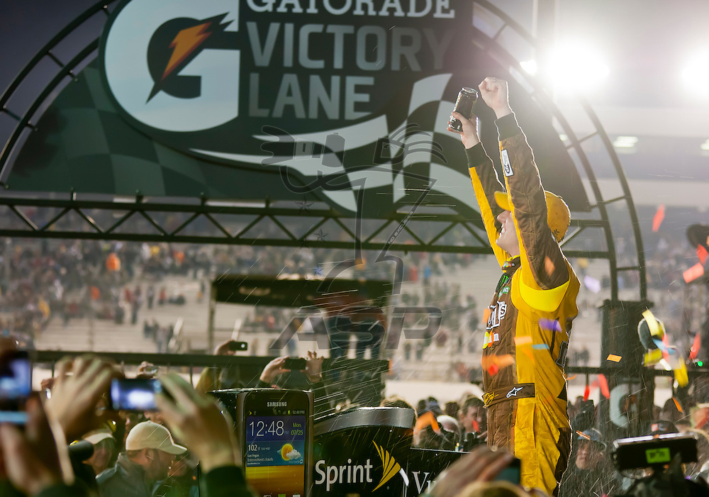 RICHMOND, VA - APR 28, 2012:  Kyle Busch (18) holds off a hard charging field to win the Capital City 400 Presented by Virginia Is For Lovers at the Richmond International Raceway in Richmond, VA.