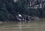 LIUZHOU, Nov. 13, 2015 (Xinhua) -- <br /> <br /> A vessel tips over in flooded Liujiang River in south China's Guangxi Zhuang Autonomous Region, Nov. 13, 2015. Heavy rainfall in recent days brought flood to many rivers in Guangxi. <br /> ©Exclusivepix Media