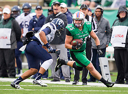 Oct 3, 2015; Huntington, WV, USA; Marshall Thundering Herd tight end Ryan Yurachek runs for extra yards during the second quarter against the Old Dominion Monarchs at Joan C. Edwards Stadium. Mandatory Credit: Ben Queen-USA TODAY Sports