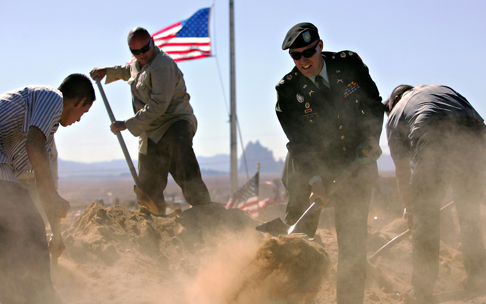 Xavier Mascareñas/The Daily Times; Maj. Xavier Miller of the New Mexico National Guard, second from right, leads family members and workers in burying Sgt. 1st Class Kenneth W. Westbrook at the veterans section of the Shiprock, N.M. Community Cemetery on Friday, Oct. 16, 2009. Westbrook was wounded Sept. 8 when insurgents attacked his unit in the Ganjigal Valley in Afghanistan, and died a month later at Walter Reed Army Medical Center. Westbrook was the second son in the family to fall in combat since 2005.