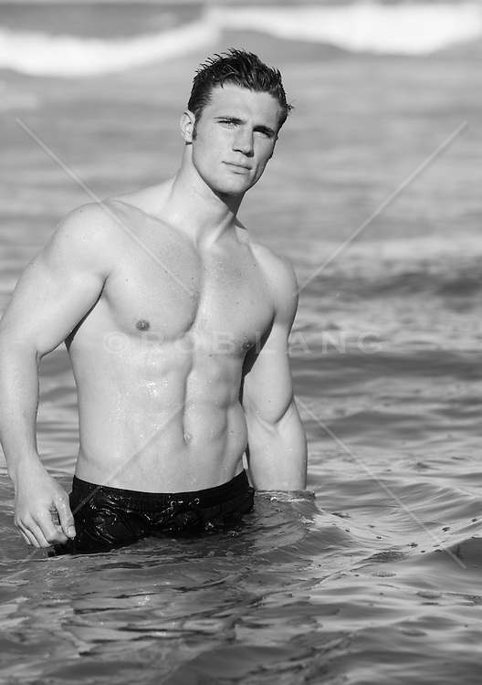 All American shirtless man in the ocean