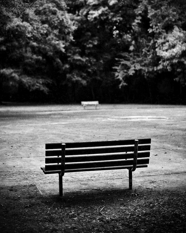 Park benches at a basketball court at Freedom Park in Charlotte, North Carolina