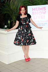 Carrie Grant poses in the Palm Court at Alexandra Palace to celebrate the opening of this year's Mums Show Live!, the UK's first exhibition aimed at parents with children aged 4 - 12 year olds, London, England, May 16, 2013. Photo by:  Chris Joseph / i-Images
