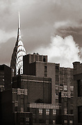 The Chrysler building in New York as viewed from the south, with brick buildings in the foreground.<br />
