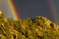 Indian Mountain with rainbow after thunderstorm; Fremont County, Colorado