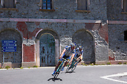 Cyclists ride Bianchi roadbikes on The Stelvio Pass, Passo dello Stelvio, Stilfser Joch, in Northern Italy