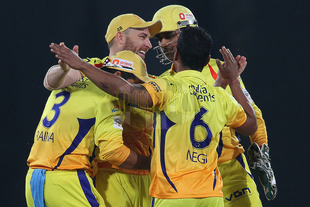 Brendon McCULLUM of the Chennai Superkings  and M S DHONI (Captain) of the Chennai Superkings celebrate the wicket of George BAILEY (Captain) of the Kings XI Punjab  during the second semi final match of the Oppo Champions League Twenty20 between the Kings XI Punjab and the Chennai Superkings held at the Rajiv Gandhi Cricket Stadium, Hyderabad, India on the 2nd October 2014<br /> <br /> Photo by:  Ron Gaunt / Sportzpics/ CLT20<br /> <br /> <br /> Image use is subject to the terms and conditions as laid out by the BCCI/ CLT20.  The terms and conditions can be downloaded here:<br /> <br /> http://sportzpics.photoshelter.com/gallery/CLT20-Image-Terms-and-Conditions-2014/G0000IfNJn535VPU/C0000QhhKadWcjYs