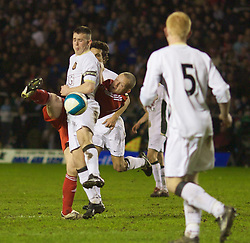 WARRINGTON, ENGLAND - Tuesday, February 26, 2008: Liverpool's Jay Spearing and Manchester United's Sam Hewson during the FA Premiership Reserves League (Northern Division) match at the Halliwell Jones Stadium. (Photo by David Rawcliffe/Propaganda)