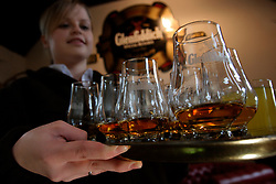 UK SCOTLAND DUFFTOWN 24JUN04 - A young Scottish guide serves a round of Whisky at the Glenfiddich destillery in Dufftown, Scotland, the world's Whisky capital. Glenfiddich is the largest family-owned single malt Whisky destillery worldwide with 80% of production destined for export.....jre/Photo by Jiri Rezac for Frankfurter Allgemeine....© Jiri Rezac 2004....Contact: +44 (0) 7050 110 417..Mobile:  +44 (0) 7801 337 683..Office:  +44 (0) 20 8968 9635....Email:   jiri@jirirezac.com..Web:    www.jirirezac.com....© All images Jiri Rezac 2004 - All rights reserved.