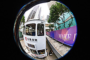 A fisheye view of the historic double decker tram as it passes Statue Square and the Hong Kong Shanghai Bank building in the central district of Hong Kong.