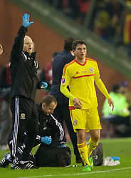 BRUSSELS, BELGIUM - Sunday, November 16, 2014: Wales' Joe Allen and physiotherapist Sean Connelly during the UEFA Euro 2016 Qualifying Group B game against Belgium at the King Baudouin [Heysel] Stadium. (Pic by David Rawcliffe/Propaganda)