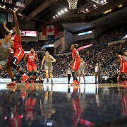 HARTFORD, CONNECTICUT- DECEMBER 19: Kia Nurse #11 of the Connecticut Huskies drives to the basket defended by Tori McCoy #0 of the Ohio State Buckeyes during the UConn Huskies Vs Ohio State Buckeyes, NCAA Women's Basketball game on December 19th, 2016 at the XL Center, Hartford, Connecticut (Photo by Tim Clayton/Corbis via Getty Images)