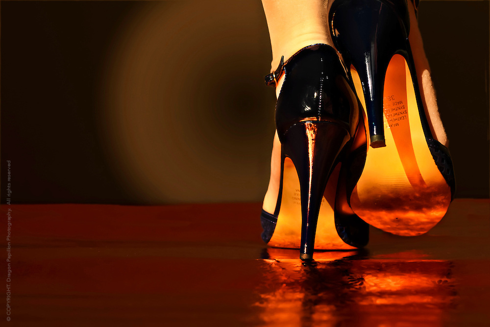 low angle perspective of high heels against golden light