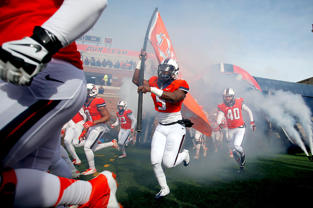 Illinois players run onto the field before the start of an NCAA college football game against Iowa at Memorial Stadium Saturday, Nov. 15, 2014, on the University of Illinois campus in Champaign, Ill. (Lee News Service/ Stephen Haas)