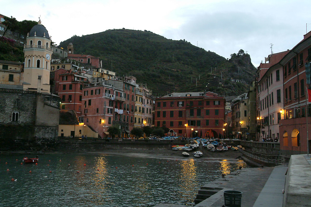 Boats docked at small harbor  at dusk in Vernazza, Cinque Terre, Italy