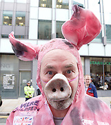 Conservative Party Conference <br /> Manchester, Great Britain <br /> Day 3<br /> 6th October 2015 <br /> <br /> demonstrator outside venue dressed as a pig <br /> <br /> <br /> Photograph by Elliott Franks <br /> Image licensed to Elliott Franks Photography Services