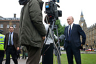 UK. London. From a story on Abingdon Street Gardens, a small patch of land, often referred to as College Green, that lies next to The Houses of Parliament in Westminster. It is a place where the media and the politicians come face to face. Interviews are held, photo shoots are set up and bewildered tourists stroll by..Photo shows former leader of The Labour Party Neil Kinnock on the day Tony Blair resigned as Britain's Prime Minister..Photo©Steve Forrest/Workers Photos