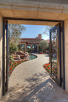 Open gate with path leading to front door