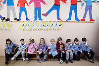 Sesta Godano, Italy - 14 January, 2013: Children of a multigrade class sit during a break in the classroom at the elementary school of Sesta Godano, Italy, on 14 January, 2013. <br /> <br /> Sesta Godano is a town in the province of La Spezia, in the Liguria region, with a population of about 1,400.  Because of a low number of children in the area, students in the elementary and seconday have been grouped in multigrade classes. According to the ISTAT (Italian National Statistical Institute) Liguria is the oldest of the Italian regions, with the highes ageing index of 232 percent compared to the national average of 144,5 percent and the EU average of 111,3 percent (data is from 2010). In Liguria there are almost twie as much deaths than births. The average age in Liguria is 48 years old. <br /> <br /> Italy is ageing. According to ISTAT, the average age will rise from 43.5 in 2011 to a maximum of 49.8 in 2059.