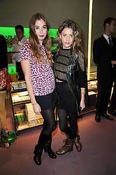 Left to right, ANOUSKA GERHAUSER daughter of Tamara Beckwith and ROSE LANGLEY at a party hosted by Prada to celebrate launch of a book documenting the company's diverse projects in fashion, architecture, film and art held at their store 16/18 Old Bond Street, London on 19th November 2009.