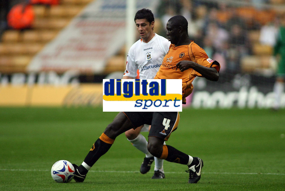 Photo: Rich Eaton.<br /> <br /> Wolverhampton Wanderers v Luton Town. Coca Cola Championship. 26/08/2006. Seyi Olofinjana right of Wolves gets to the ball ahead of Lutons Kevin Foley