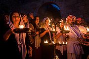 Yazidis gather outside the Holy Temple in Lalish to celebrate the first Yazidi New Year since victory over ISIS was declared in Iraq.