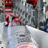 01 March 2009:      The Austria 1 bobsled driven by Wolfgang Stampfer with sidepushers Juergen Mayer and Gerhard Koehler, and brakeman Juergen Loacker glance at the clock as they finish their 8th place run at the 4-Man World Championships competition on March 1 at the Olympic Sports Complex in Lake Placid, NY.   The USA 1 bobsled driven by Steven Holcomb with sidepushers Justin Olsen and Steve Mesler, and brakeman Curtis Tomasevicz won the competition and the World Championship bringing the U.S. their first world championship since 1959 with a time of 3:36.61.
