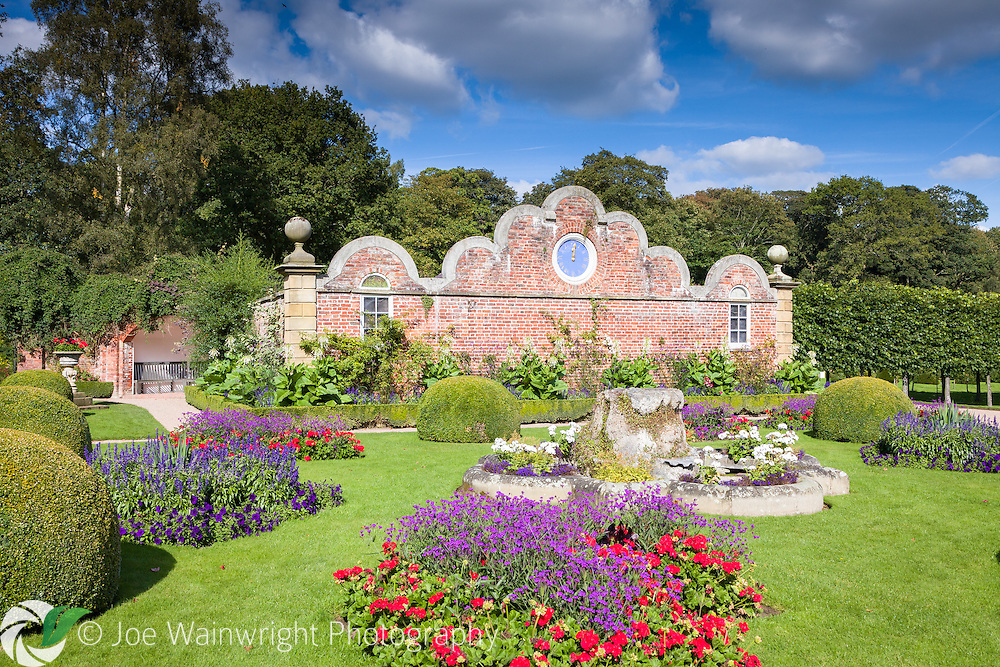 The Victorian Parterre at Erddig Hall, Wrexham, North Wales. The bedding plants are pictured, still in full flower, on a late September afternoon.