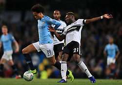 """Manchester City's Leroy Sane and Fulham's Timothy Fosu-Mensah (right) battle for the ball during the Carabao Cup, Fourth Round match at the Etihad Stadium, Manchester. PRESS ASSOCIATION Photo. Picture date: Thursday November 1, 2018. See PA story SOCCER Manchester. Photo credit should read: Mike Egerton/PA Wire. RESTRICTIONS: EDITORIAL USE ONLY No use with unauthorised audio, video, data, fixture lists, club/league logos or """"live"""" services. Online in-match use limited to 120 images, no video emulation. No use in betting, games or single club/league/player publications."""