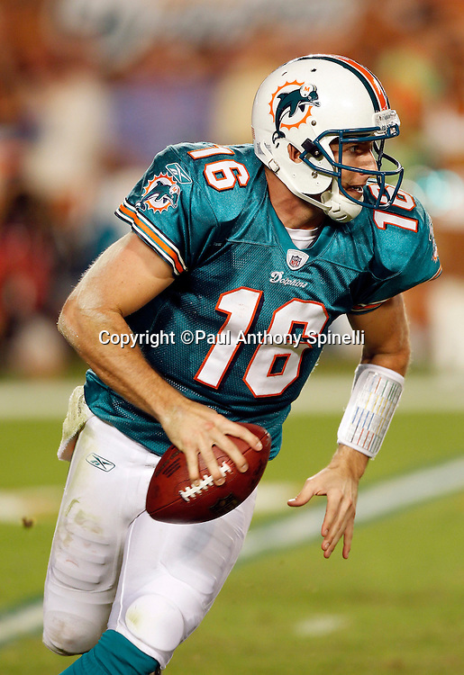 Miami Dolphins quarterback Tyler Thigpen (16) rolls out while looking to pass during the NFL week 11 football game against the Chicago Bears on Thursday, November 18, 2010 in Miami Gardens, Florida. The Bears won the game 16-0. (©Paul Anthony Spinelli)