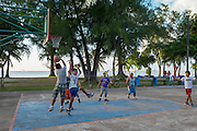 Playing a pickup game of hoops at the beach in town, Saipan.