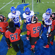 William Penn and Middletown shake hands at midfield prior to the start of DIAA State Championship football game between William Penn and Middletown Saturday, Nov. 29 2014, at Delaware Stadium in Newark Delaware.