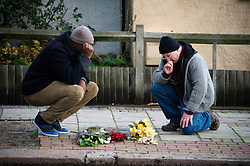 Two people lay flowers at the Stephen Lawrence Memorial in Eltham , South East London after the Guilty verdict Tuesday, 3rd January 2012. Photo by: i-Images