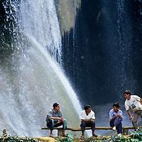 Tourists at Kuang Si Waterfall, Luang Phrabang, Laos