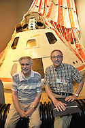 L-R, FRANK PULLO, 82, of Wantagh, and ROY VAN COTT are sitting in front of a Command Module CM 002 with deployed parachute at a Summer of '69 Celebration Event, during the reunion of former Northrop Grumman Aerospace Corporation employees, held at the Long Island Cradle of Aviation Museum, on the 45th Anniversary of NASA Apollo 11 LEM landing on the moon July 20, 1969. Pullo, a 30 year employee of Grumman, was an electrical manager of LEM 9 and 11 and chief test conductor of LEM 6. Van Cott was structural designer on descent stage and brought the original plans for descent stage engine support structure with him to the reunion.