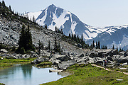 See Overlord Mountain from Overlord Trail on Blackcomb Mountain, in Garibaldi Provincial Park, the Coast Range, British Columbia, Canada. The Resort Municipality of Whistler is popular for year-round  outdoor sports aided by gondolas and chair lifts.