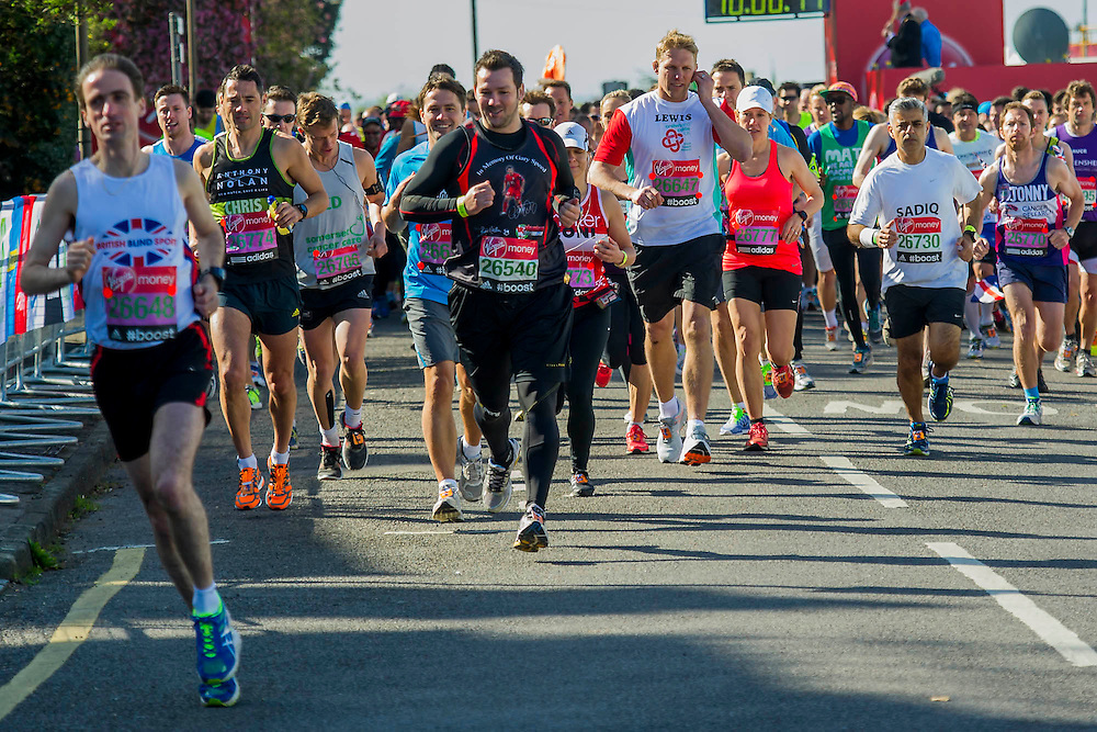 Sadiq Khan, Lewis Moody and others lead the way at the celebrity start. The London Marathon starts in Greenwich on Blackheath passes through Canary Wharf and finishes in the Mall. London UK, 13 April 2014.   Guy Bell, 07771 786236 guy@gbphotos.com