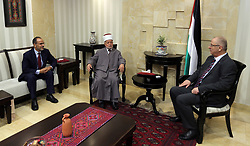 August 3, 2017 - Ramallah, West Bank, Palestinian Territory - Palestinian Prime Minister, Rami Hamdallah, meets with Mufti of Jerusalem and Palestine, Sheikh Mohammed Hussein,in the West Bank city of Ramallah, on August 3, 2017  (Credit Image: © Prime Minister Office/APA Images via ZUMA Wire)