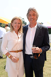 NICK & EIMEAR COOK at the Veuve Clicquot Gold Cup, Cowdray Park, Midhurst, West Sussex on 21st July 2013.