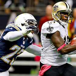 October 7, 2012; New Orleans, LA, USA; New Orleans Saints wide receiver Devery Henderson (19) catches a pass in front of San Diego Chargers cornerback Quentin Jammer (23) during the fourth quarter of a game at the Mercedes-Benz Superdome. The Saints defeated the Chargers 31-28. Mandatory Credit: Derick E. Hingle-US PRESSWIRE