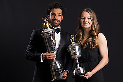 Lauren Hemp with the PFA Young Female Player Of The Year Award Trophy (right) and Liverpool's Mohamed Salah poses with the PFA Player Of The Year Award Trophy during the 2018 PFA Awards at the Grosvenor House Hotel, London